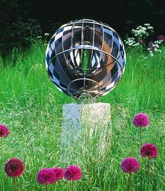 Maya spherical sundial - this David Harber innovation creates an optical illusion of a solid, free-floating central sphere. The dial comprises 24 stainless steel crescents, an hour band and rings to represent the Tropics of Cancer and Capricorn.
