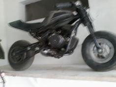 mini moto projeto de 2003 sistema de traçao motriz conjugado com eixo do molejo do quadro elastico.