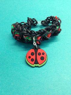 A cute Bandaloom bracelet with a ladybug charm.