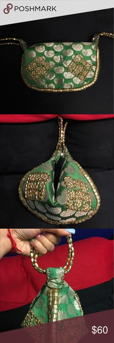 Emerald Jeweled Ethnic Paisley Clutch from Dubai Gorgeous Emerald Green Jeweled Ethnic Paisley Clutch made and bought in Dubai. Can be worn with or without being buttoned. Handles are like bangles. Absolutely beautiful & one of a kind!!! Can be worn with a casual outfit or with a party and/ or Desi dress. Bags Clutches & Wristlets