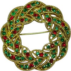 Vintage Weiss Red Green Rhinestone Christmas Wreath Brooch $25.00 This is a beautiful vintage wreath brooch by Weiss. This lovely classic brooch is