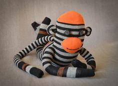 Super cute sock monkey with fall colors! Maybe baby shower gift? https://www.etsy.com/listing/206867794/sock-monkey-orange-grey-black-striped
