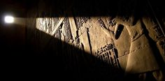 Edfu Light within Light enters through a small window and impinges embossed inside the Temple of Edfu in Egypt,