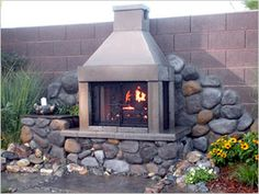 As it gets cold up North, we were looking for great outdoor DIY fireplaces.  This one really looks unique and fun to build.