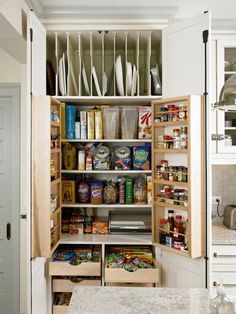 The floor-to-ceiling, 40-inch-wide pantry outfitted with shelves and drawers is large enough to store all those bulk-purchased goods. Bonus: The pantry is right next to the island, where the kids sit for afternoon snacks, so it helps them help themselves. The refrigerator-style hinges all around the kitchen are a special touch. Kenna added a latch detail to the outside of the pantry because it reminded her of an icebox she had growing up.
