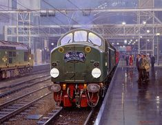 Railway Artist: Malcolm Root FGRA.New Era A class 40 diesel loco pulls out of London's Liverpool Street station with The Hook Continental boat train in 1963..18