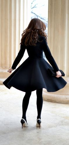 Fall/Winter Outfit - Long Navy Blue Coat That Flares Out Past The Waist Paired With Black Tights And Heels. Such A Coat And Choice Of Shoe Slims Down Both The Waist And Legs.