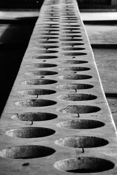 Latrines inside a wooden barracks of the BIIa sector of the Auschwitz II-Birkenau camp.
