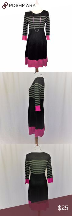 """Eliza J Fit and Flare Black and Pink Sweater Dress A lovely and lightweight fit and flare sweater dress in black with striking deep fuchsia border.  Length: 37"""" Sleeve: 19"""" Bust from pit to pit: 16"""" Size M 100% Acrylic Machine wash cold Eliza J Dresses Long Sleeve"""
