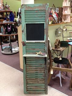Antique shutter shelf with chalkboard and hooks. $165.00, via Etsy.