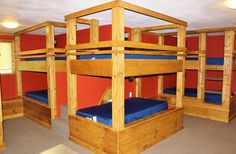 Our Retreat Center offers two luxury bunk rooms that can sleep 14 in the Red Room (pictured) and 12 in the Green Room.