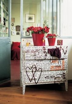 I'm really thinking about going in the word direction. In my head I'm seeing black body, white top and drawers, then I write all over the drawers like this one. Only without the stamps.