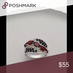 Black Spinel and Garnet Ring Rhodium Plated Sterling Silver ring decorated with Black Spinel and Garnet. 14 mm width . Size 7 Jewelry Rings