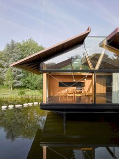 Architecture studio Hamish & Lyons has completed Stepping Stone House, an extension to a manor house in Berkshire, England, that is raised… Space Architecture, Residential Architecture, Organic Structure, Water House, Small Lake, Floating House, House Extensions, Stone Houses, Building A House