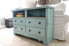 Antiqued blue Dresser with top drawers removed into burlap shelf