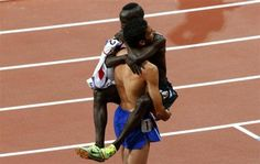 First place finisher Kenya's Ezekiel Kemboi (top) hugs second place finisher France's Mahiedine Mekhissi-Benabbad as they celebrate after the men's 3000m steeplechase final during the London 2012 Olympic Games at the Olympic Stadium August 5, 2012. REUTERS-David Gray