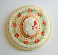 Cameo with Roses decorated sugar cookies hand painted by cookie artist Arty McGoo. More art than cookie!