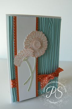 stampsnsmiles.blogspot.com  What a great wood grain embossing folder!