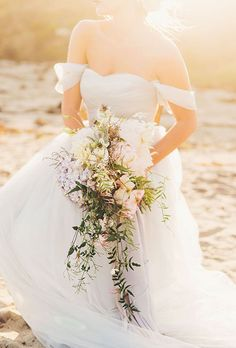 Loose Bouquet of Pale Pink Peonies, Hydrangea, Clematis, and Greenery. A romantic bouquet comprised of peonies, hydrangea, clematis, and greenery, created by Eden Floral Design.