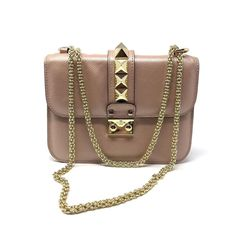 valentino champagne small glam rock shoulder bag  strap can be shoulder or crossbody  excellent condition with card and dustbag  asking $1280  comment for more information or to purchase this item