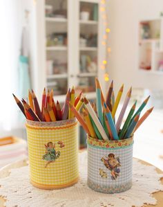 scrap papers, washi tapes & vintage stickers  to transform tin cans into pencil holders.