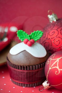 Festive cupcake with red Christmas baubles -  by Ruth Black