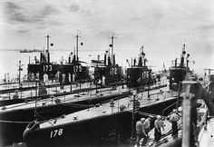 Nested together, circa Probably seen from USS Canopus in Manila Bay, Philippines. The inboard submarine is not identified. The others are (from left to right): USS Pike USS Tarpon USS Porpoise USS Perch and USS Permit Us Navy Submarines, German Submarines, Bataan, History Online, United States Navy, Navy Ships, Water Crafts, Military History, World War Ii