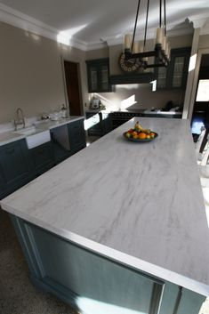 Corian - rain Cloud. I couldnt bring myself to put marble in the kitchen -- I…