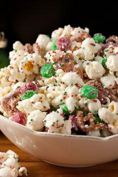 Kid favorite Christmas munchy. Popcorn, vanilla candy melts, pretzel pieces, red and green M&Ms and holiday sprinkles.
