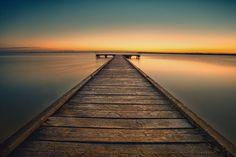 Sunrise on lake by Ronald König on Railroad Tracks, Sunrise, Sidewalk, Scenery Photography, Side Walkway, Walkway, Sunrises, Walkways, Train Tracks
