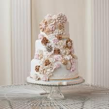 Sweetface Cakes | 3-tier round cream white cake with multi flower design in fondant
