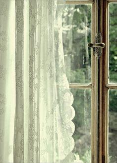 Sunshine through lace curtains.