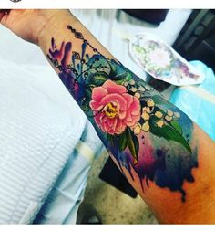 Amazing watercolor tattoo of peony and Lilly of the valley flowers.