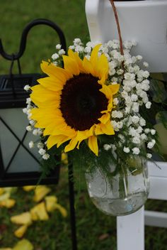 sunflowers in mason jars.. simple and perfect center pieces!!!