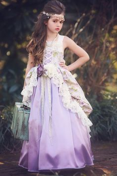 """Our """"Springtime In Paris""""  Gown is a romantic confection of lilac, sage, and cream, and is guaranteed to make her feel like royalty!"""