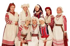 a variety of regional costumes with namitka head coverings.