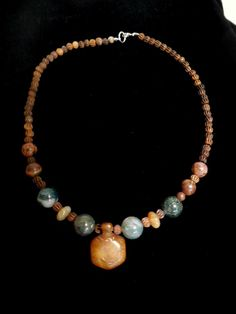 Chunky earth tones of Jasper, Sediment stones and small brown bone beads are centered with a bone turtle bead.