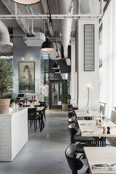 I love this restaurant design … it's just stunning in its minimal, industrial style. Using huge amounts of concrete, accented with black lacquered steel & iron, white tiles, steel sheeting, maple wood