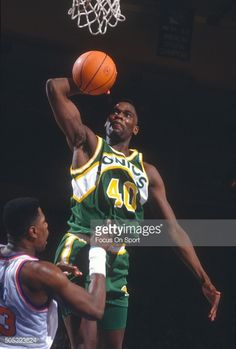 Shawn Kemp of the Seattle Supersonics goes up for a slam dunk over Patrick  Ewing of 75780456b
