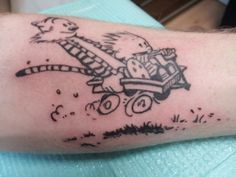 Calvin and Hobbes! What a great tat. I love these guys. How cool.