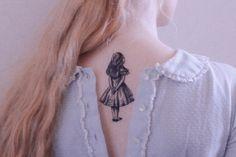 Alice tattoo.