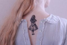Alice tattoo.
