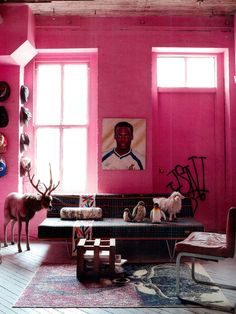 Eclectic pink living space full of eccentric pieces.