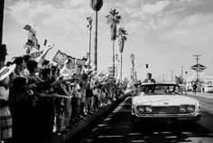 JFK campaigng San Fernando Valley, near Valley Plaza. Woman in backseat is his sister, not Jackie.