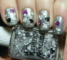 Yeti's Broken Heart (Heights of Hawaii Collection) (1/2014) a clear-based glitter polish with white circles, hexes and squares, purple, black and white hearts and little bits and pieces of white, purple and black glitter pieces. It also has tiny blue shimmer/flecks