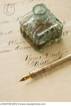 Beautiful letter in calligraphy, antique bottle and quill pen.