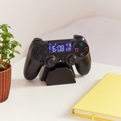 PlayStation Alarm Clock - This is an alarm clock in the design of a PlayStation controller. What a sick gift for gamers, or even just someone who longs for the trill of an authentic alarm clock rather than their iPhone's 'radar'. Playstation, Gamer Gifts, Tech Gifts, Ultimate Gaming Room, Cadeau Star Wars, Boy Room, Kids Room, Gamer Bedroom, Geek Decor