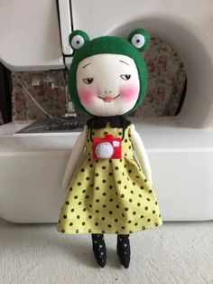 Handmade green smiling frog doll with camera by EEchingHandmade