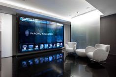 Futuristic Video Wall in Knoxville, TN. Museum Exhibition Design, Design Museum, Exhibition Space, Office Interior Design, Office Interiors, Office Reception Design, Donor Wall, Media Wall, Waiting Area