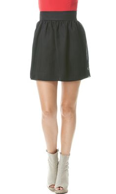 Peep toe booties are all the rage this fall. Pair with a feminine skirt for a look that's sure to turn heads.